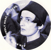 Severe but hep image of Ayn Rand and her cigarette holder during her friendly 1947 HUAC testimony