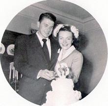 Nancy and Ronald Reagan cut their wedding cake