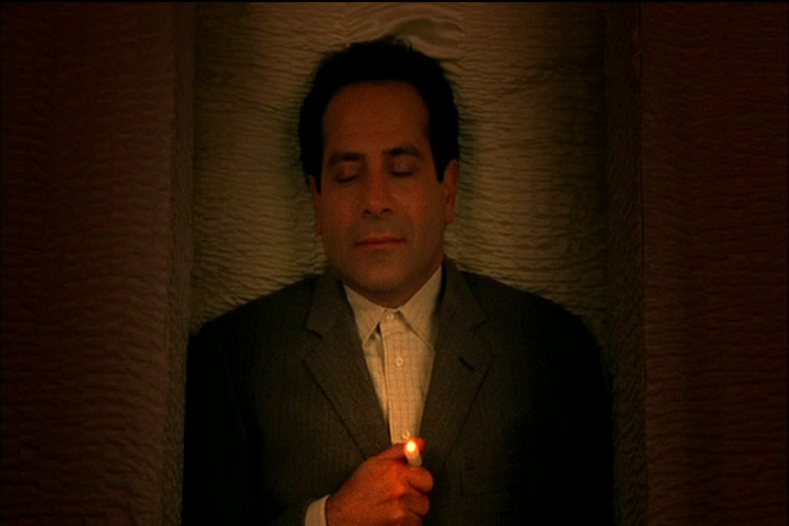 Adrian Monk in a coffin