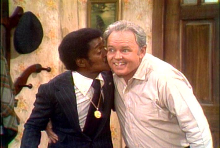 Sammy Davis, Jr. (left) kisses Carroll O'Connor during scene of All in the Family