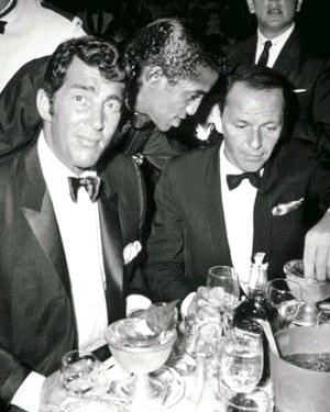 Dean Martin, Sammy Davis Jr and Frank Sinatra - a word in the chairman's ear