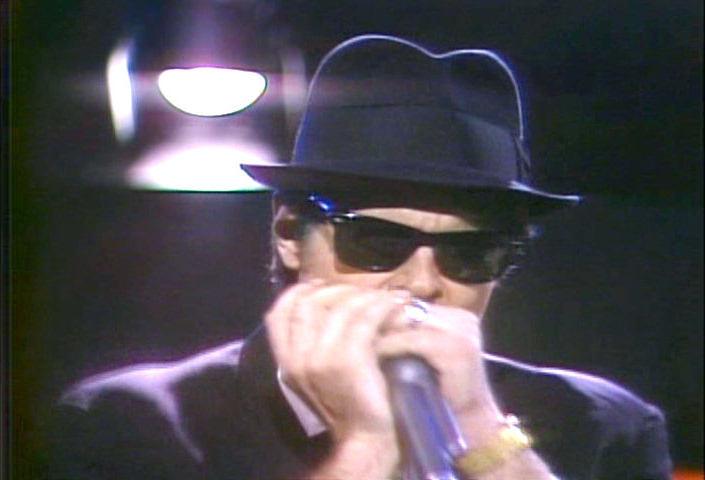 Dan Akroyd blowing harmonica, 1978 image