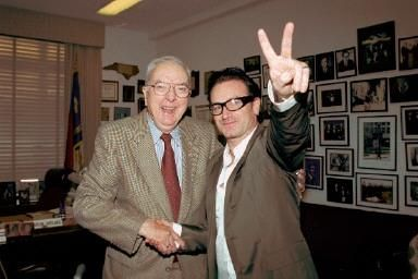 Bono shaking hands with Jesse Helms