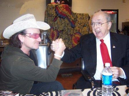 Jesse Helms arm wrestling Bono