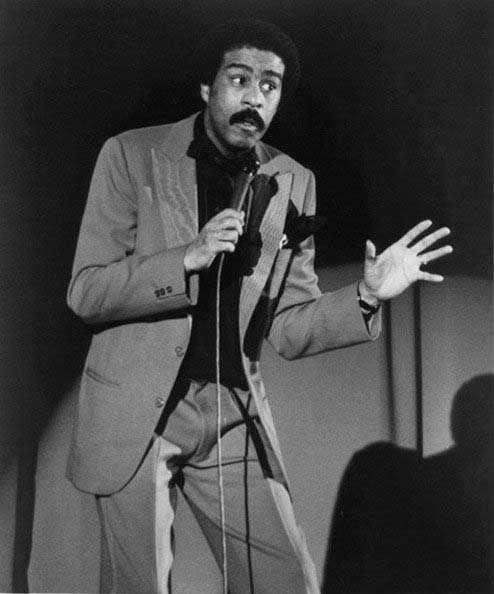 black and white Richard Pryor concert photo