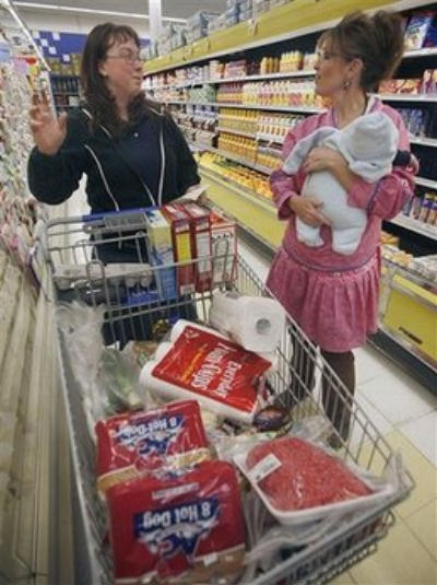 A voter runs into the governor with her newborn at the grocery store