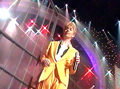 David Bowie in a highly gay canary yellow suit