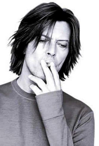 David Bowie smoking a cigarette