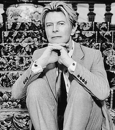 black and white photo of David Bowie in a suit and tie