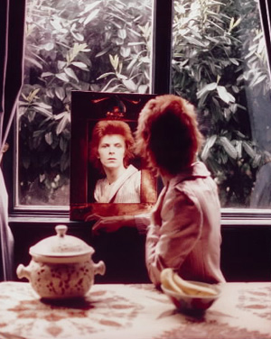 David Bowie looks in the mirror