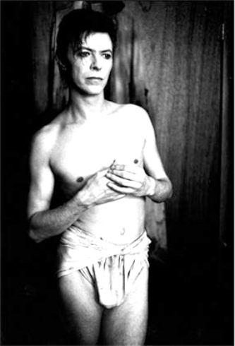 David Robert Jones in a loincloth