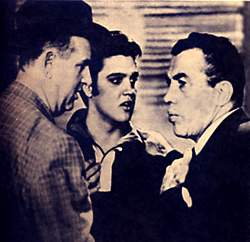 Ed Sullivan chats with Tom Parker and Elvis Presley