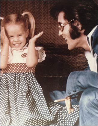 daddy's girl Lisa Marie Presley playing peek-a-boo with Elvis