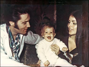 casual picture of mom and dad with baby Lisa Marie Presley