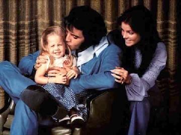 Elvis Presley kissing young Lisa Marie