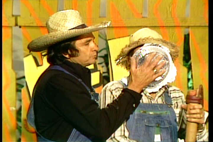 Johnny Cash smashes Archie Campbell in the face with a cream pie