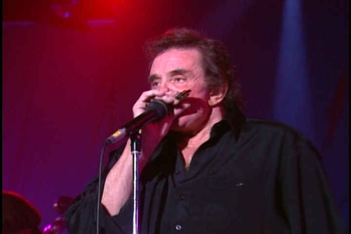 June Carter and Johnny Cash Pictures 44 - Johnny Cash playing harmonica