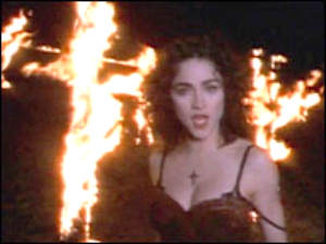 Madonna Louise Ciccone dancing in front of burning crosses in her infamous 'Like a Prayer' video