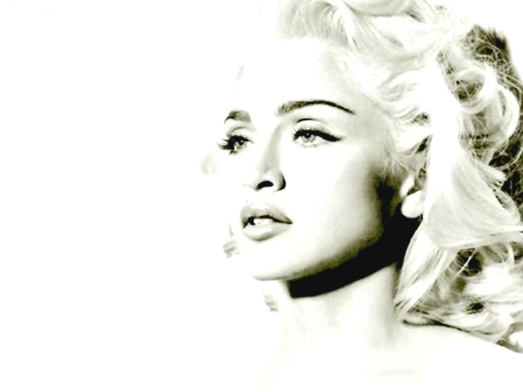 http://www.morethings.com/music/madonna/madonna-wallpaper-115.jpg