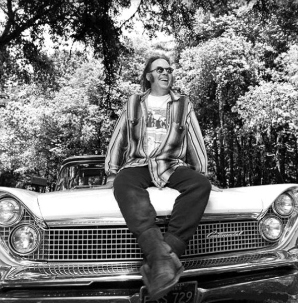 Neil Young on a car