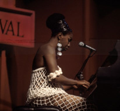 Nina Simone in a white macrame dress