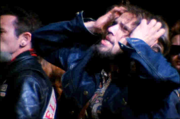 Fan freaking out on stage during the Rolling Stones' Altamont concert
