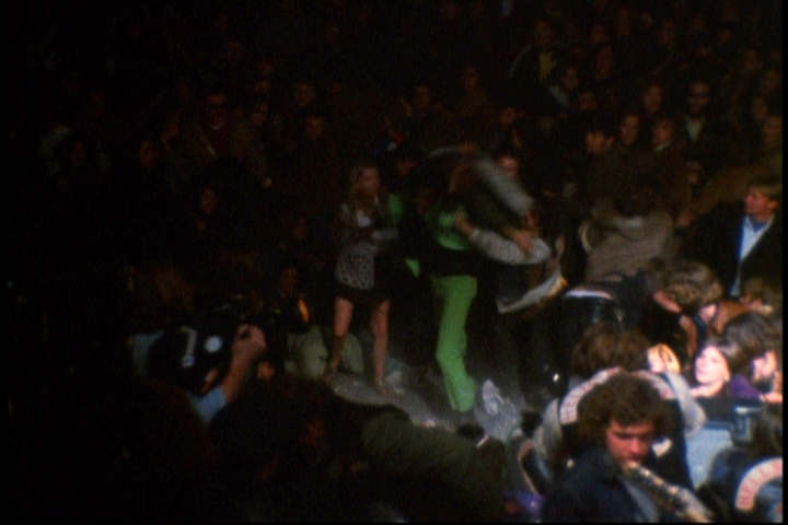 "Hell's Angel Alan Passaro stabbing Meredith Hunter while the Rolling Stones play ""Under My Thumb"" at the 1969 Altamont Music Festival"