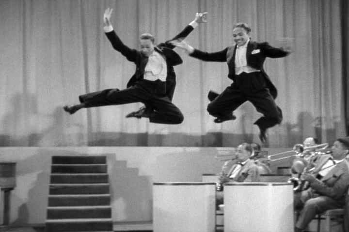 Fayard and Harold Nicholas fly through the air with the greatest of ease in Stormy Weather, 1943
