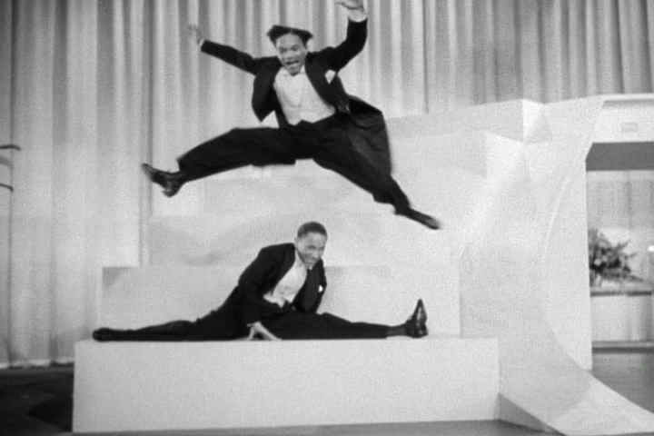 Fayard and Harold Nicholas with the Cab Calloway orchestra in Stormy Weather