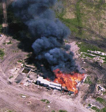 http://www.morethings.com/pictures/batf-waco/waco_burning.jpg