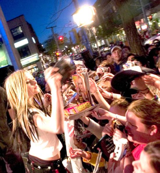 Avril Lavigne greeting her fans