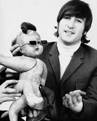 John Lennon with a doll
