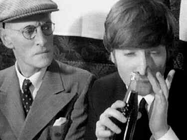 John Lennon sniffing a coke