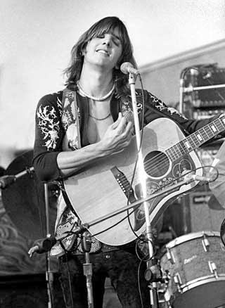 Gram Parsons on stage