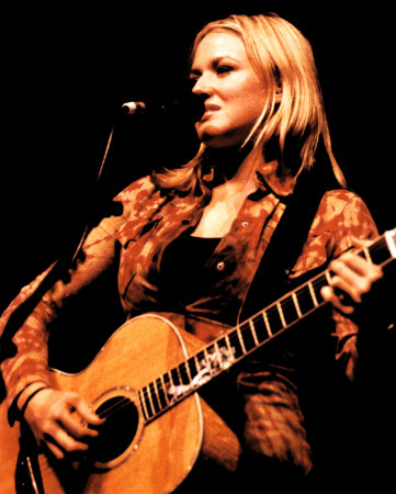 Jewel Kilcher playing guitar