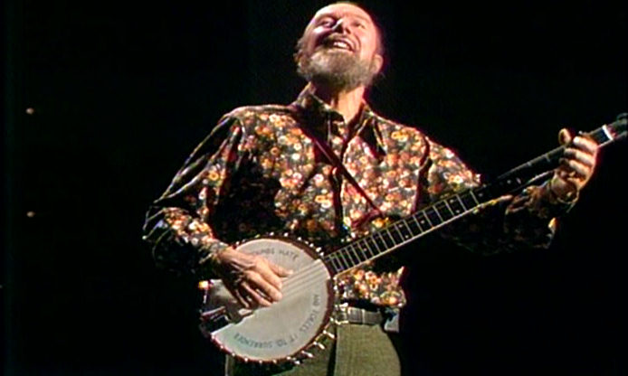 Pete Seeger picking banjo